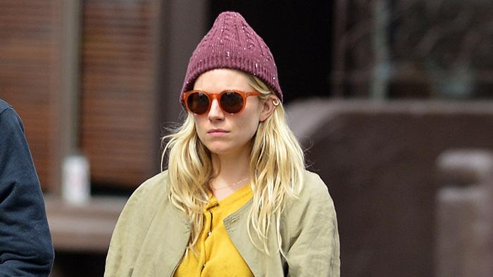 Sienna Miller walks around in the West Village in New York City