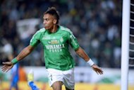 Saint-Etienne's Gabonese forward Pierre-Eme Aubameyang celebrates after scoring during the French L1 football match against Troyes at the Geoffroy Guichard Stadium. Saint-Etienne beat Troyes 2-0, while Valenciennes recovered to beat Bastia 3-2 as both sides drew to within one point of Ligue 1 leaders Paris Saint-Germain