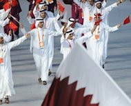 Qatar's delegation parades during the 2008 Beijing Olympic Games opening ceremony. Qatari female shooter Bahiya al-Hamad will carry the country's flag at the opening ceremony of the Olympic Games in London on July 27, the Qatari Olympic Committee announced on Wednesday on Twitter