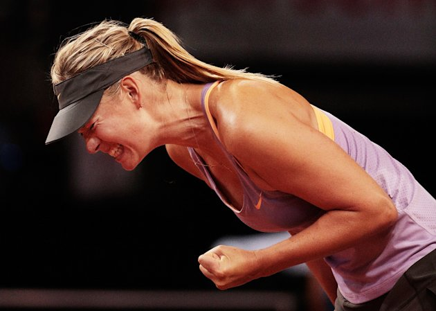 STUTTGART, GERMANY - APRIL 22: Maria Sharapova of Russia celebrates a point during her first round match against Lucie Safarova of the Czech Republic during day 2 of the Porsche Tennis Grand Prix 2014 at Porsche-Arena on April 22, 2014 in Stuttgart, Germany. (Photo by Adam Pretty/Bongarts/Getty Images)