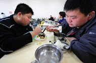 This file photo, taken on November 18, 2008, shows patients eating their lunch at a weight reduction clinic in Tianjin in northern China. There are an estimated 347 million diabetes sufferers worldwide and diagnoses are increasing, particularly in developing countries, due to growing levels of obesity and physical inactivity