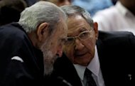 Cuban former president Fidel Castro (left) listens to his brother and current president, Raul, as Cuba's new National Assembly meets to choose a Council of State, at the Conventions Palace in Havana on February 24, 2013.