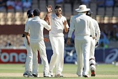 Ashwin (C) celebrates after getting the wicket of Ed Cowan of Australia during day three of the Fourth Test between Australia and India at Adelaide Ov...