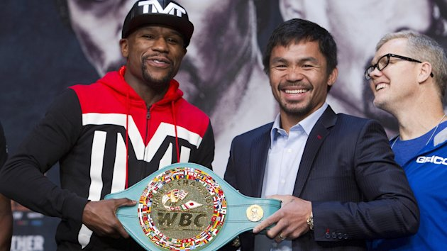 Undefeated WBC/WBA welterweight champion Floyd Mayweather Jr. (L) of the U.S. and WBO welterweight champion Manny Pacquiao of the Philippines pose with the WBC championship belt during a final news conference at the MGM Grand Arena in Las Vegas, Nevada Ap