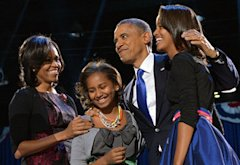 US President Barack Obama accompanied by (from L-R ) First Lady Michelle and daughters Sasha and Malia | Photo Credits: Jewel Samad/AFP/Getty Images