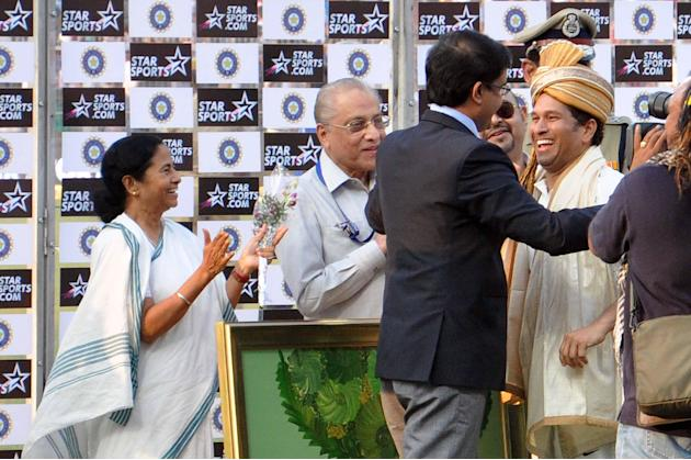 West Bengal Chief Minister Mamata Banerjee and former BCCI President Jagmohan Dalmiya clap as former cricketer Sourav Ganguly hugs master blaster Sachin Tendulkar as India won 1st test match between I