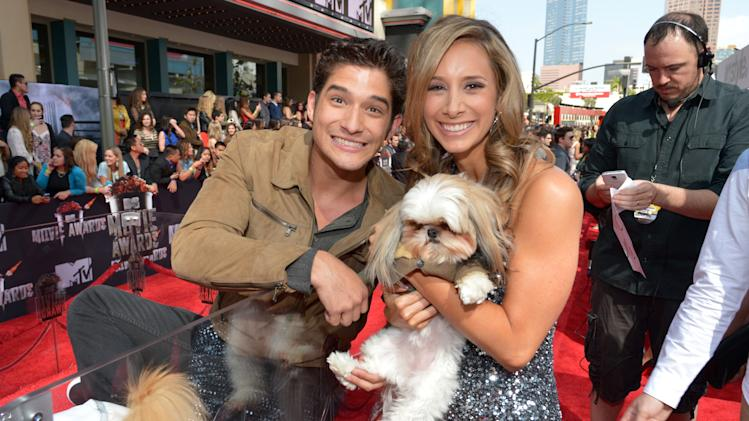 Tyler Posey, left, and MTV's Christina Garibaldi arrive at the 2014 MTV Movie Awards, on Sunday, April 13, 2014 in Los Angeles. (Photo by John Shearer/Invision for MTV/AP Images)