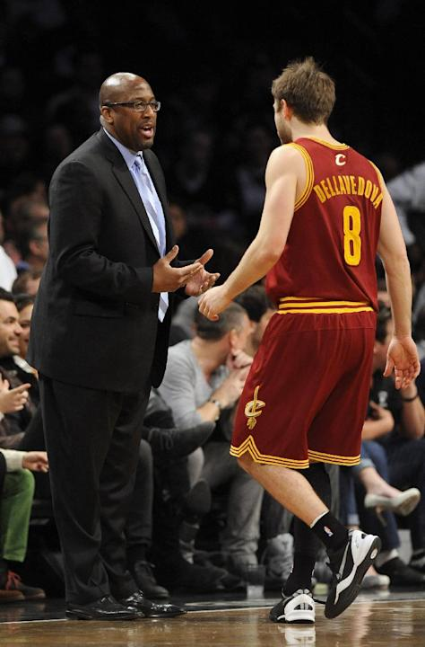 Cleveland Cavaliers head coach Mike Brown talks with Cleveland Cavaliers guard Matthew Dellavedova (8) during an NBA basketball game against the Brooklyn Nets on Friday, March 28, 2014, in New York. T