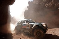 Mini driver Stephane Peterhansel and co-pilot Jean Paul Cottret, both of France, race during the Dakar Rally between the cities of San Miguel de Tucuman and Salta, Argentina, Friday, Jan. 10, 2014. (AP Photo/Jean-Paul Pleissier, Pool)