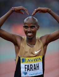 Britain's Mo Farah celebrates after winning the men's 5,000m at the 2012 Diamond League athletics meet at Crystal Palace in London. Farah delighted the home crowd with a pulsating win in 13min 6.04sec