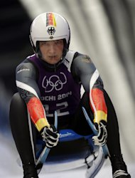 Tatjana Huefner of Germany brakes in the finish area during a training session for the women's singles luge at the 2014 Winter Olympics, Saturday, Feb. 8, 2014, in Krasnaya Polyana, Russia. (AP Photo/Dita Alangkara)