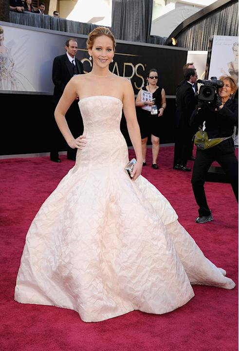 "Best Actress front-runner Jennifer Lawrence (""Silver Linings Playbook"") hit the red carpet at the 2013 Oscars in a confusing dress. Is she trying to be a bride? The all-white strapless numbe"