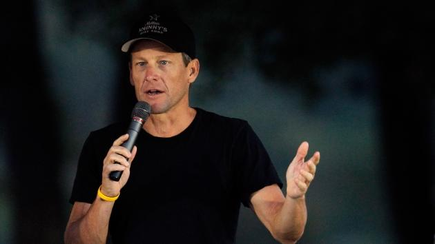 Cyclist Lance Armstrong addresses participants at The LIVESTRONG Challenge Ride at the Palmer Events Center on October 21, 2012  -- Getty Images