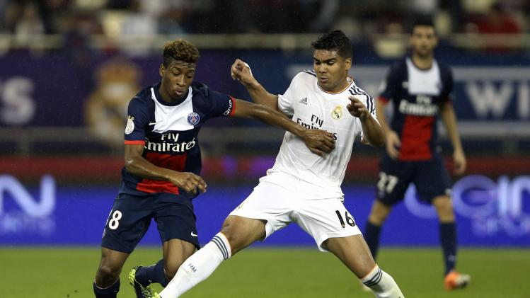 Real Madrid's Casemiro challenges Paris St Germain's Kingsley Coman during their friendly soccer match at Khalifa stadium in Doha