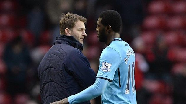 Tim Sherwood and Emmanuel Adebayor (Reuters)