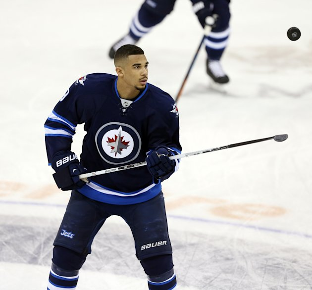 Jan 13, 2015; Winnipeg, Manitoba, CAN; Winnipeg Jets forward Evander Kane (9) plays with the puck prior to the game against the Florida Panthers at MTS Centre. (Bruce Fedyck-USA TODAY Sports)