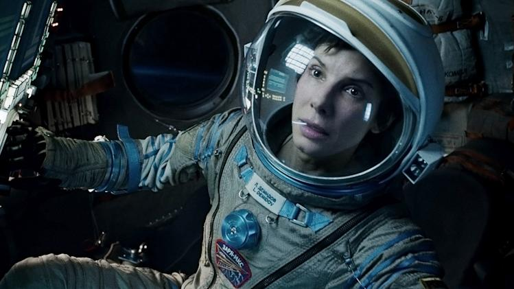 "This film image released by Warner Bros. Pictures shows Sandra Bullock in a scene from ""Gravity."" Bullock says making the lost-in-space movie directed by Alfonso Cuaron was her ""best life decision"" ever. (AP Photo/Warner Bros. Pictures)"