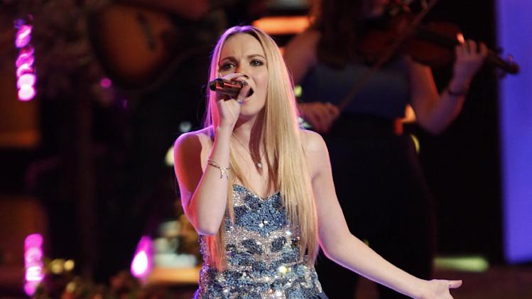 "This June 17, 2013 photo released by NBC shows finalist Danielle Bradbery performing on the singing competition series ""The Voice,"" in Los Angeles. Bradbery will compete against Michelle Chamuel and brother duo Zach and Colton Swon during the finale on Tuesday, June 18. (AP Photo/NBC,Tyler Golden)"