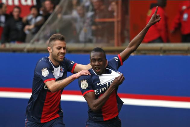 Paris St Germain's Matuidi celebrates with Menez after scoring a goal against Evian Thonon Gaillard during their French Ligue 1 soccer match at the Parc des Princes Stadium in Paris