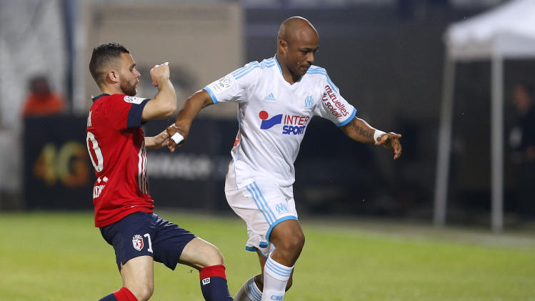 Olympique Marseille's Ayew challenges Martin of Lille during their French Ligue 1 soccer match in Marseille