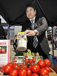 A man checks vegetables for radiation on April 12, 2011. The clean-up around the stricken Fukushima nuclear plant is expected to take decades and experts warn that some settlements may have to be abandoned