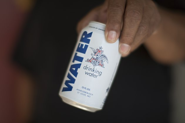 A can of water donated by the Anheuser-Busch company in the fourth year of worsening drought on February 11, 2015 in East Porterville, California. (Photo by David McNew/Getty Images)