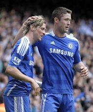 Chelsea's Fernando Torres (L) celebrates scoring his second goal with teammate Gary Cahill, against Leicester City, during their FA Cup quarter-final match at Stamford Bridge in London, on March 18. Chelsea advanced to the semis where they will play Tottenham, on Sunday