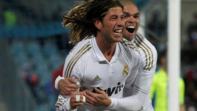 Real Madrid's Sergio Ramos ( L ) celebrates after scoring with his teammate Pepe against Getafe during their Spanish First Division soccer match at Colisseum Alfonso Perez stadium in Getafe February 4, 2012