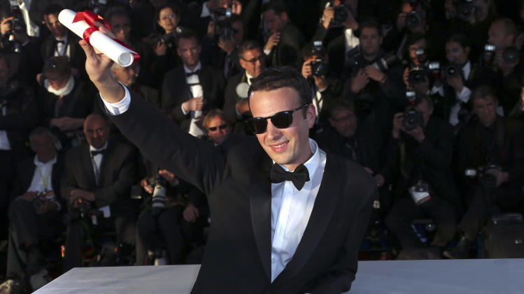 Director Amat Escalante poses with the Best Director award for his film Heli during a photo call after an awards ceremony at the 66th international film festival, in Cannes, southern France, Sunday, May 26, 2013. (Photo by Joel Ryan/Invision/AP)
