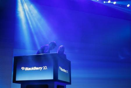 Workers prepare the stage ahead of the launch of Research In Motion Ltd's (RIM) new Blackberry 10 devices in New York