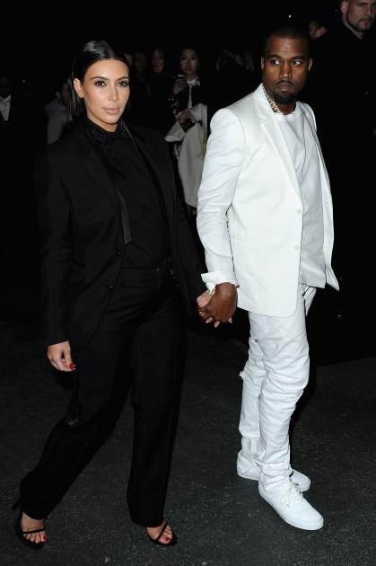 Kim Kardashian and Kanye West are spotted holding hands at the Givenchy Fall/Winter 2013 Ready-to-Wear show in Paris on March 3, 2013 -- Getty Images