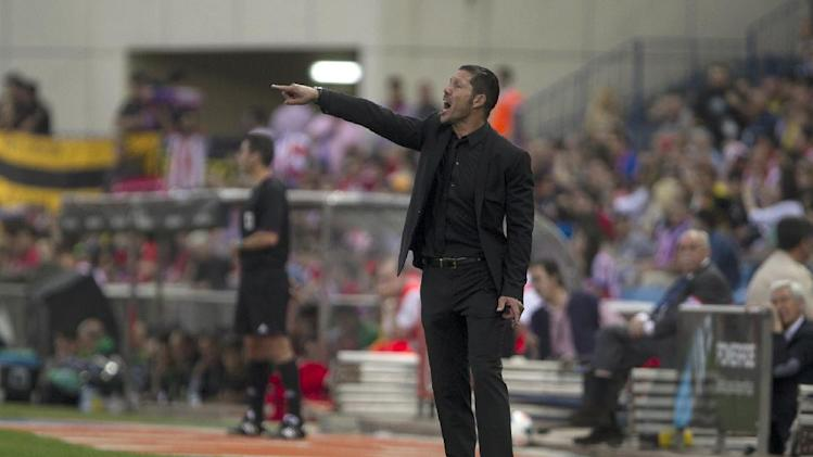 Atletico's coach Diego Simeone gestures during a Spanish La Liga soccer match between Atletico de Madrid and Elche at the Vicente Calderon stadium in Madrid, Spain, Friday, April 18, 2014