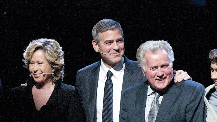 "From left to right, actress Yeardley Smith, actor George Clooney, and actor Martin Sheen take a bow during the curtain call at the Los Angeles premiere of the play ""8"" in Los Angeles on Saturday, March 3, 2012. (AP Photo/Dan Steinberg)"