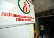 "A patient weights at a clinic where many marginal groups receive medical treatment for HIV/AIDS in Jakarta. Nearly half of transgender people in the Asia-Pacific region could have HIV as poor healthcare and high-risk lifestyles push infection rates to ""critical levels"", a UN report said Thursday"
