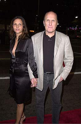 Robert Duvall and woman at the Mann's National Theater premiere of Columbia's The 6th Day