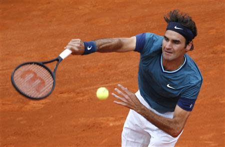 Federer of Switzerland serves to Stepanek of the Czech Republic during the Monte Carlo Masters, in Monaco