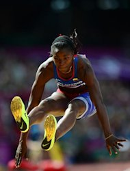Colombia's Caterine Ibarguen competes in the women's triple jump qualifying rounds at the athletics event during the London 2012 Olympic Games on August 3, 2012 in London. AFP PHOTO / FRANCK FIFE