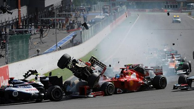 Romain Grosjean, Ferrari's Spanish Fernando Alonso and McLaren Mercedes' British Lewis Hamilton crash (AFP)