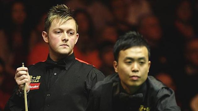 SNOOKER Mark Allen watches Marco Fu during the 2011 Masters final