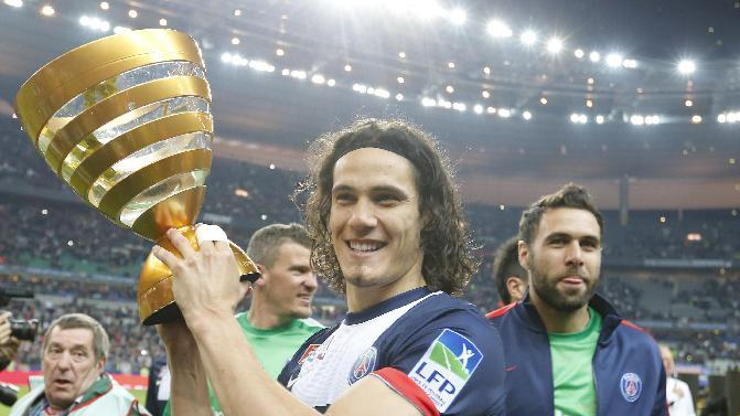 Paris Saint Germain's Edinson Cavani of Argentina, center, and goalkeeper Salvatore Sirigu, right, pose with the trophy after winning the French League Cup Final soccer match against Lyon at the Stade de France in Saint Denis, north of Paris, Saturday April 19, 2014