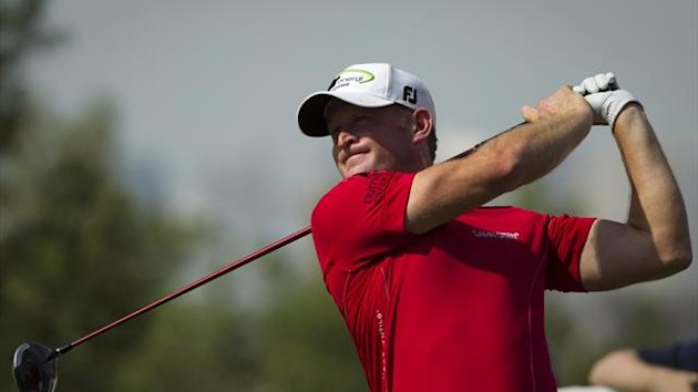 Jamie Donaldson of Britain watches his shot during the first round of the DP World Tour Championship in Dubai November 14, 2013 (Reuters)
