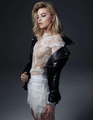 Margot Robbie wears BLK DNM jacket; Nina Ricci dress; Isabel Marant shorts (underneath); Efva Attling ear cuff; (from top) Efva Attling ring, John Hardy band rings, Giles & Brother ring, ManiaMania ring. Beauty note: Hair gets nice and loud with Kérastase Resistance Volumifique.