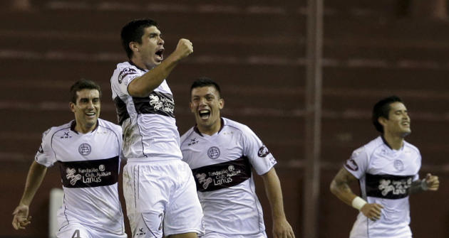 Matias Martinez of Argentina's Lanus, second from left, celebrates after scoring against Mexico's Santos Laguna at a Copa Libertadores soccer match in Buenos Aires, Argentina, Wednesday, April