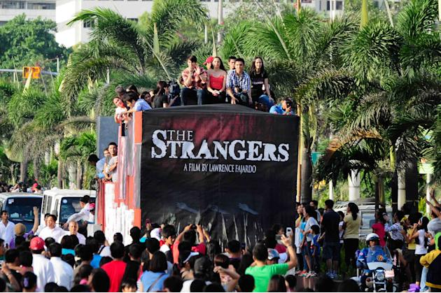 "The float of the MMFF 2012 entry ""The Strangers"" makes its way through the crowd at the 2012 Metro Manila Film Festival Parade of Stars starting on 23 December 2012. (Angela Galia/NPPA Images)"