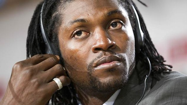 Emmanuel Adebayor of Togo adjusts his earpiece during his official presentation at the Santiago Bernabeu stadium in Madrid Thursday Jan. 27, 2011. Adebayor has agreed a six-month loan spell with the Spanish giant after falling out of favor of Roberto Manc