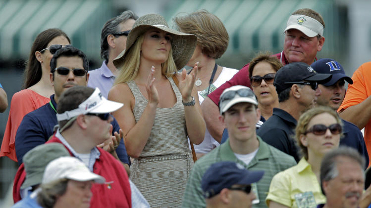 Skier Lindsey Vonn applauds as she watches Tiger Woods  during the first round of the Masters golf tournament Thursday, April 11, 2013, in Augusta, Ga. (AP Photo/Matt Slocum)