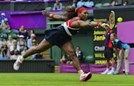 Serena Williams of the US returns to Serbia's Jelena Jankovic during their women's singles tennis match at the London 2012 Olympic Games at the All England Tennis Club in Wimbledon, southwest London. Serena won 6-3, 6-1