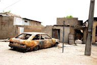 A house and car are ravaged by a bomb explosion by the Islamist group Boko Haram in Maiduguri, northeastern Nigeria, in May 2012. More than 1,000 Nigerians have fled to neighbouring Niger after six people were killed in an attack on their village blamed on Islamist group Boko Haram, the United Nations said Thursday.