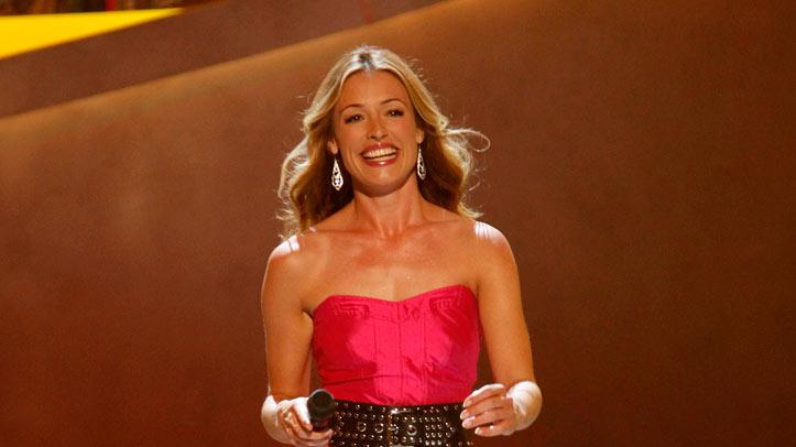 "For the Top 14 performance show of Season 5 of ""So You Think You Can Dance,"" Cat Deeley pulled off a Sarah Jessica Parker-inspired outfit by cinching her hot pink DVF dress with a studded belt from Temperley London and Sonya Rykiel."