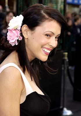 Premiere:  No, that's not you that Alyssa Milano is looking so coyly and flirtatiously at - it's some really buff, handsome rich guy at the Hollywood premiere of Warner Brothers' The Matrix: Reloaded - 5/7/2003